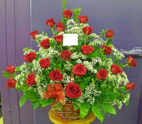Wicker Basket of Two Dozen Red Roses from Clark Flower and Gift Shop in Clark, SD