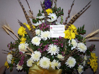Mixed Blooms with Wheat & Pheasant Feathers from Clark Flower and Gift Shop in Clark, SD