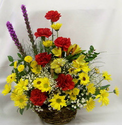 Wicker Basket of Bright Blooms from Clark Flower and Gift Shop in Clark, SD