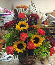 Wicker Basket of Fall Blooms from Clark Flower and Gift Shop in Clark, SD