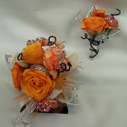 Orange Spray Roses & MiniCarnations Wrist Corsage from Clark Flower and Gift Shop in Clark, SD