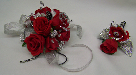 Red Spray Roses with Silver Accents Wrist Corsage from Clark Flower and Gift Shop in Clark, SD