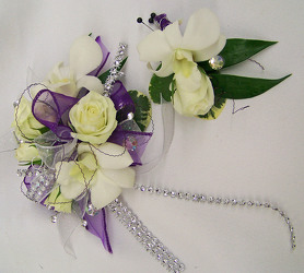 White Wrist Corsage with Purple & Silver Accents from Clark Flower and Gift Shop in Clark, SD