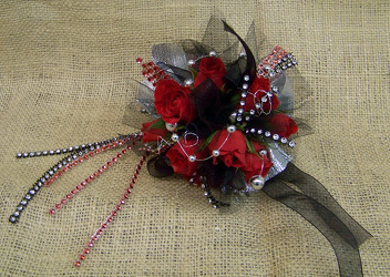 Red & Black Wrist Corsage from Clark Flower and Gift Shop in Clark, SD