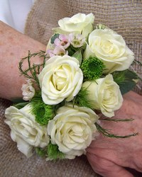 Wrist Corsage Cuff of White Spray Roses from Clark Flower and Gift Shop in Clark, SD