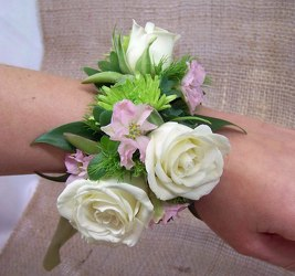 Wrist Corsage of Spray Roses & Succulents & Fillers from Clark Flower and Gift Shop in Clark, SD
